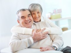 senior-couple-hugging-at-home_1098-1297